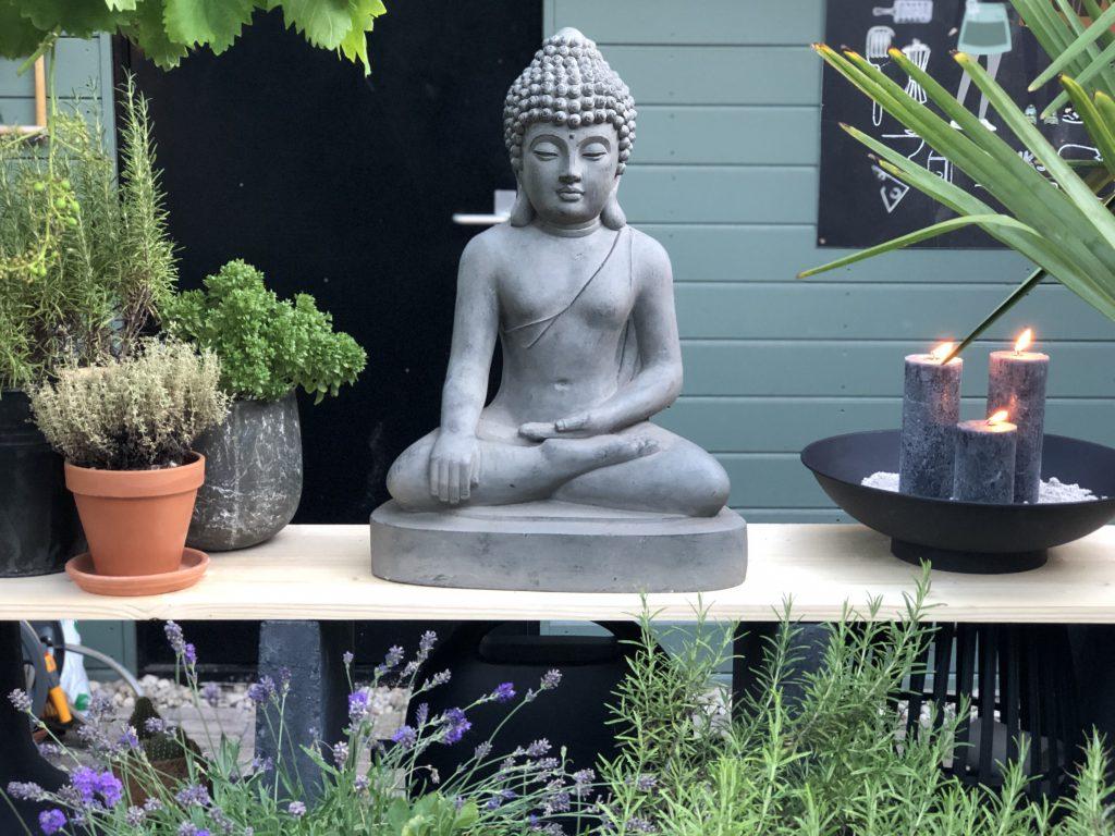 Een boeddha maakt het plaatje helemaal compleet